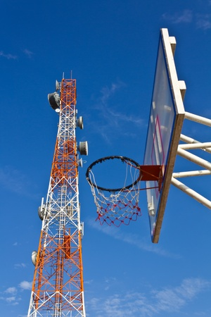 Telecommunications tower located above the old basketball hoop  Stock Photo - 13085815