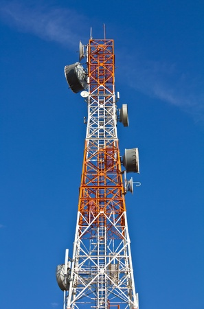 Telecommunications tower under a blue sky  Stock Photo