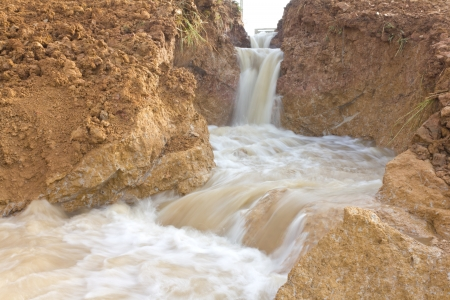swiftly: Surface soil with a waterfall that flows swiftly down to the ground to collapse  Stock Photo