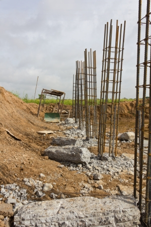 reinforcing bar: Broken concrete to the steel piles of concrete that is buried into the soil  Stock Photo