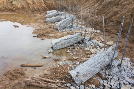 breaking down: Breaking down concrete piles embedded into the soil to be prepared for a long iron rod