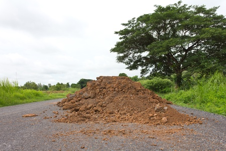 Large trees and preparing the ground for repair of roads in rural areas  Stock Photo