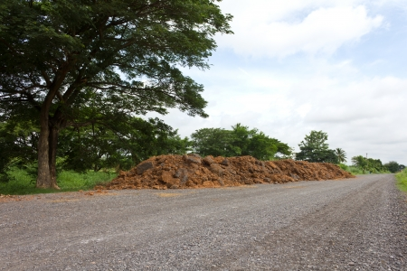 Are low in view of preparing the soil to repair the road in a rural area  photo