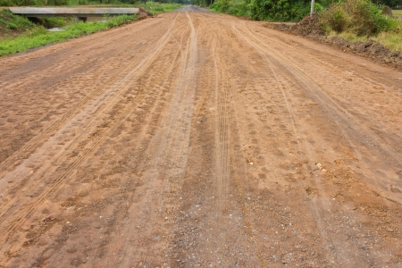 Traces of the wheels of cars and motorcycles on the roads in rural areas on the ground after a rain  Stock Photo - 14546631