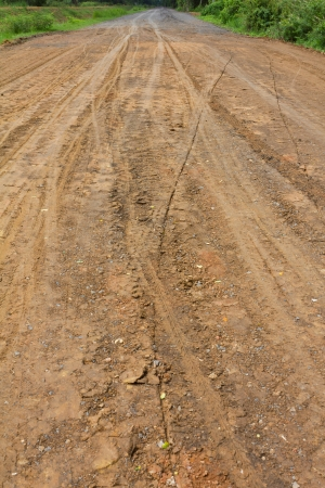 Traces of the wheels of cars and motorcycles on the roads in rural areas on the ground after a rain Stock Photo - 14546633