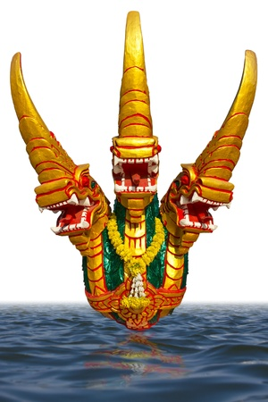 Isolates of the three-headed golden dragon sculpture which floats on the surface of the water  photo