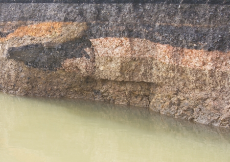 Layer of soil under the asphalt which was eroded by the massive flooding  photo