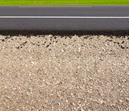 Rock and soil material on the new paved road in the rural areas  photo