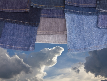 Hanging leg jeans are superimposed on a background of the cloudy sky with  photo