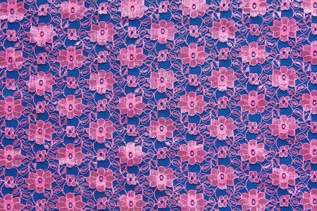 Pink floral woven fabric Thailand  Blue background  photo