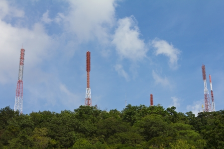Telecommunications towers are located on the cloud forest and beautiful sky background Stock Photo - 16390579