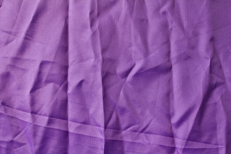 bedsheets: Texture of purple fabric with creased crumpled in soft light