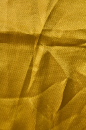crease: Crumpled yellow textured fabric with a crease