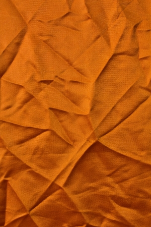 Orange fabric texture with square corners creased creases crumpled  photo