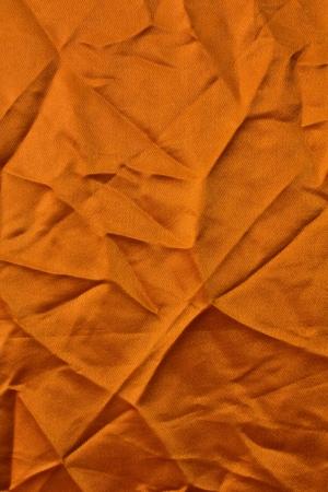 creases: Orange fabric texture with square corners creased creases crumpled  Stock Photo