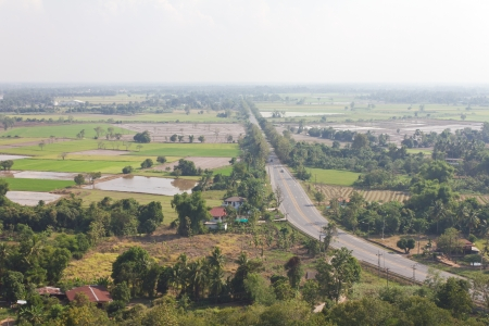 Above view of the road in rural Thailand with transportation  And agriculture coexist harmoniously  photo