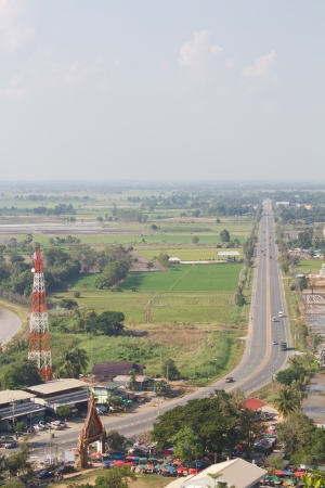 coexist: Above is a view of rural Thailand Telecommunications, Transportation  And agriculture coexist harmoniously