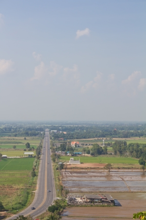 Above view of the road in rural Thailand with transportation  And agriculture coexist harmoniously  Stock Photo - 16778568