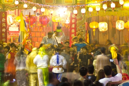 People watch the show at night, in the tradition of Thailand.