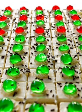 greatly: Isolates of cake squares with a green and red jelly on it greatly  Stock Photo