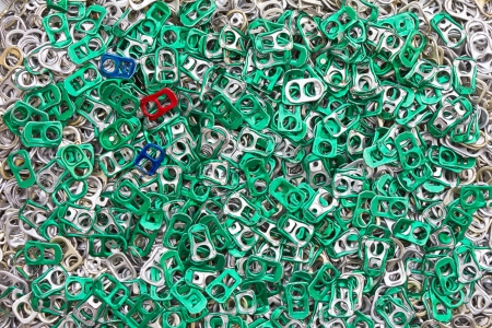Background of many ring pull can opener, silver and green   photo