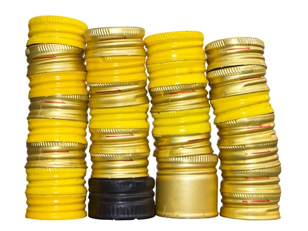 multilayer: Isolates of yellow bottle caps stacked multi-layer, multi-row and a black one