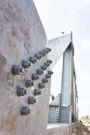 Details of the screw that attaches parts riveted steel bridge together  photo