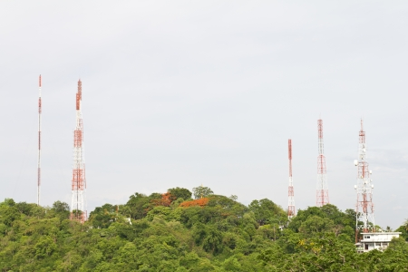 Telecommunications towers are located on the cloud forest and sky background Stock Photo - 19785942