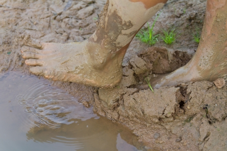 Feet of a man was trampled and stepped onto the muddy ground naturally  Stock Photo