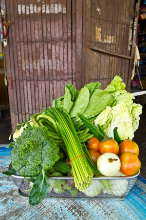 Vegetables which are placed in the wire mesh tray which typical restaurants of Thailand Stock Photo - 20234345
