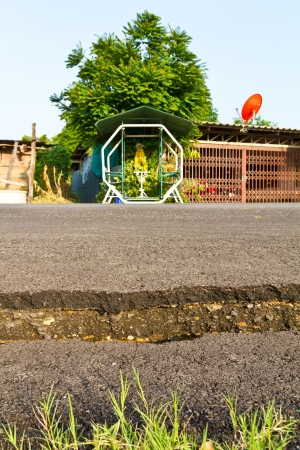 Low angle of the asphalt to break a residential house located opposite