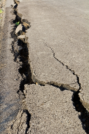 Side of the asphalt road surface crack due to ground collapsing  photo