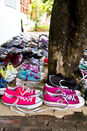 secondhand: Retail second-hand shoes, which put on a old brick and lined up neatly on the way