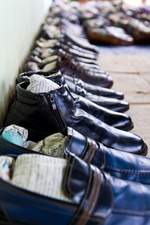 Retail sale of shoes, black leather, which laid on the floor  photo