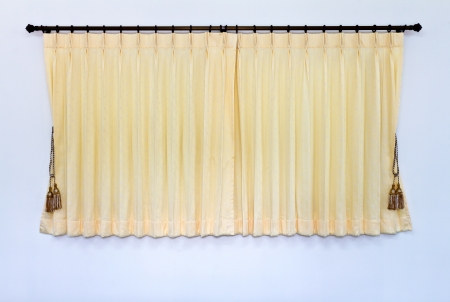 wall bars: Background of yellow curtain was closed, which hung on the wall bars stainless white gracefully