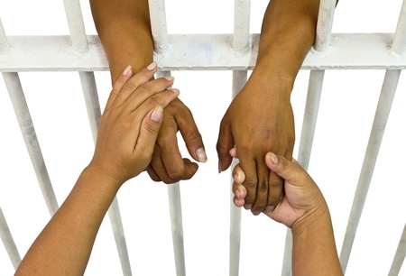 View from above of female hand holding her husband, who was incarcerated   Stock Photo - 20979154