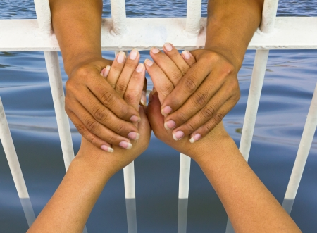 Man holding the hand of a woman who was trapped in a cage of water flooding  Stock Photo - 21085139