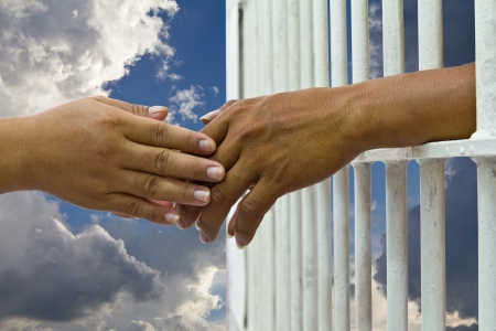 Convinces her husband to prison for a handshake with a cloud sky background  photo