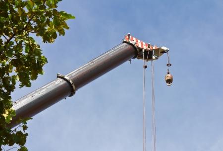 Hydraulic crane beams of large elongated heads the sky  photo