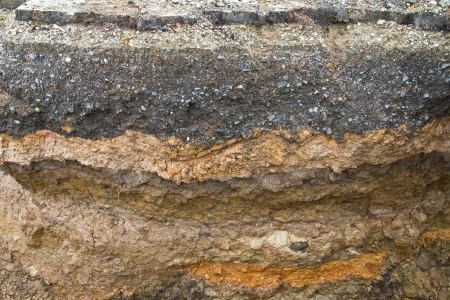 Soil under the asphalt surface of the road, which was severely eroded  Stock Photo