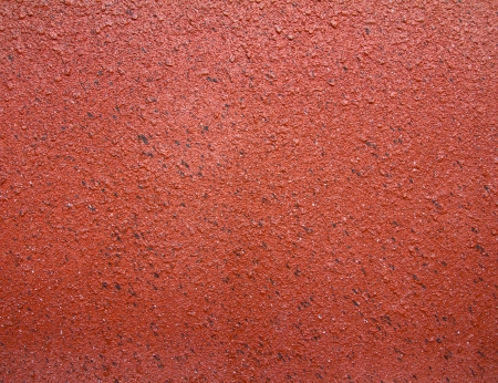 Surface of sandstone plastered concrete walls, orange and brown  photo