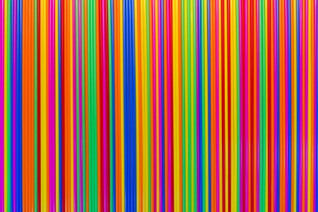 Background of many colorful plastic tubes which are arranged beautifully  photo