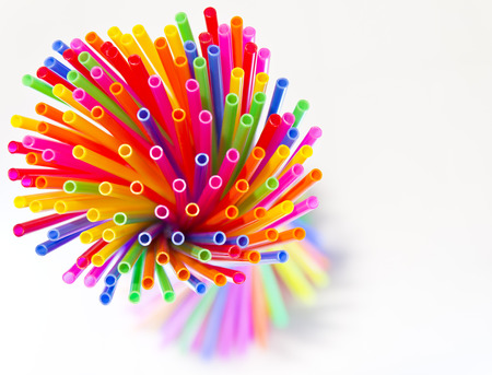 Isolated close-above many colorful plastic tubes twisted into a circle  photo