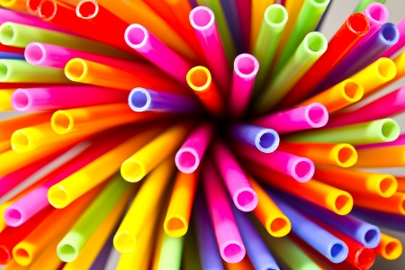 Close-up above many colorful plastic tubes twisted into a circle  photo