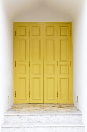 Entrance is yellow door and a marble staircase in the ancient temple of Thailand  photo