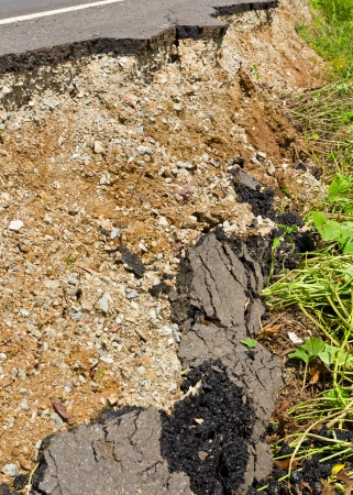 Side of the broken asphalt road collapsed and fallen, since the ground collapsing  photo