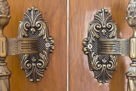 Old wooden door handles, a brass antique bronze  photo