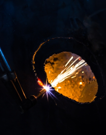 Cutting Fire drill steel sheet into a circular hole  photo