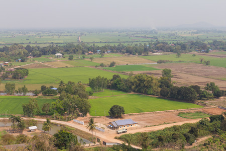 Top view of farmland to housing in the village, one of Thailand