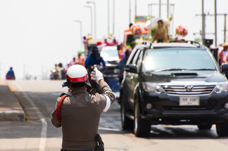 Thailand police use hand signals to force the convoy on the road  Editorial
